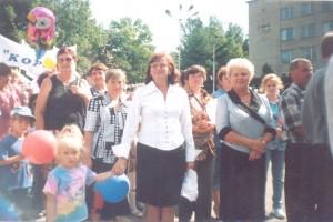 С внучкой и коллегами в День любимого города