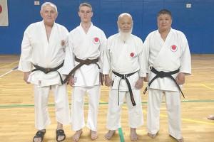 Вадим Борисоглебский (второй слева) среди мастеров каратэ